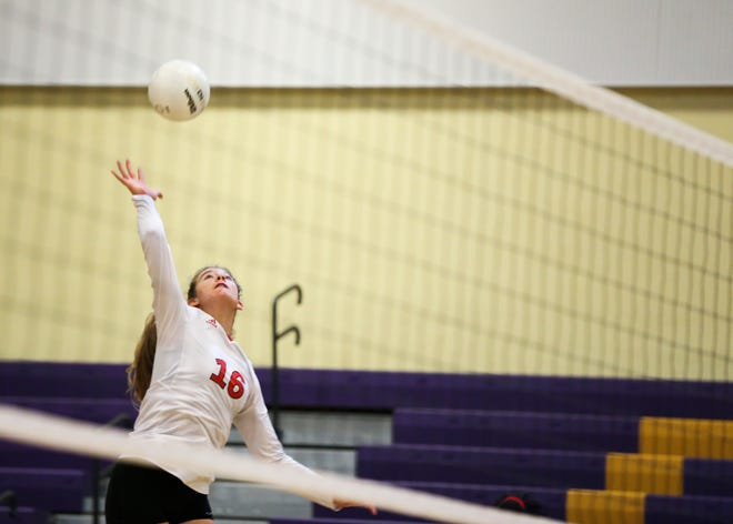 Vero Beach's Madison Gravlee (16) hits the ball over the net.