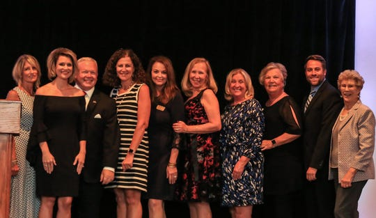 Gigi Suntum, left, Roxanne Hall, Monte Kosoff, Gina Thompson, Lisa Rymer, Wendie Berardi, Melanie Forget, Lucy Corley, Shane Bevilacqua and Suzanne Horstman at the 2018 National Philanthropy Day Awards for St. Lucie and Martin counties.