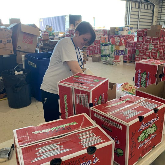 Mara, a student at Pace Center for Girls in Fort Pierce, prepares a box of hurricane supplies for Bahamas relief  Missionary Flight International in Fort Pierce.