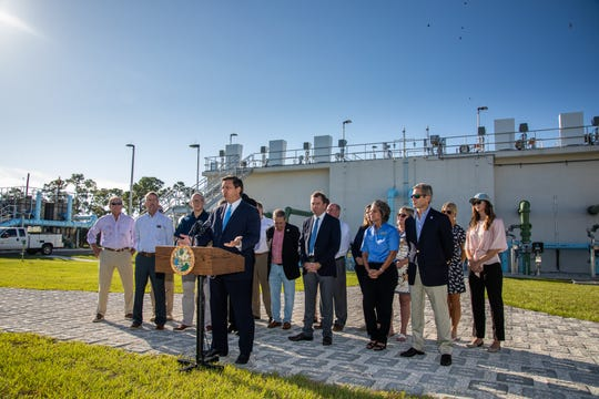 Gov. Ron DeSantis, at the Loxahatchee River District headquarters in Jupiter, flanked by members of his cabinet as well as other appointed and elected government officials, announces legislation aimed at cleaning Florida's waters.