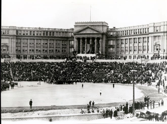 A joyous crowd, led by James A. Dick, pledges allegiance to the flag as the 11:30 a.m. ceremony gets underway at El Paso High School Stadium on Nov. 11, 1918.