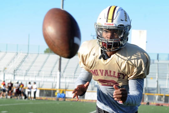 Running back Ranell White has his eyes on the prize while making a catch during Simi Valley's football practice Tuesday. White, a senior transfer from Illinois, has rushed for 490 yards and five touchdowns for the Pioneers, who play at Oak Park on Friday night in a Coastal Canyon League showdown.