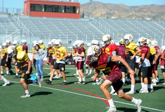 The Simi Valley High football team prepares Tuesday for its showdown at Oak Park on Friday night.