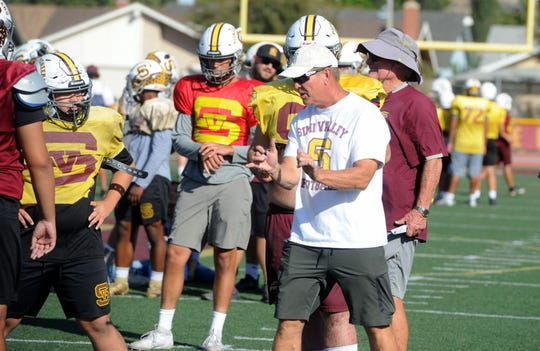 Head coach Jim Benkert has some pointers for his Simi Valley High football team during Tuesday's practice. The Pioneers play at Oak Park in a Canyon League showdown Friday night.