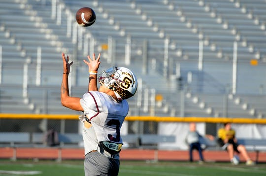 Simi Valley High's Malik Hunt, who has been one of the area's top receivers the past two seasons, makes an over-the-shoulder catch at practice Tuesday. The Pioneers play at Oak Park on Friday night in a Canyon League opener.