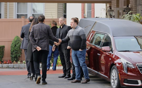 Mourners arrive at the F. Ruggiero and Sons funeral home in Yonkers for the funeral service for Altin Nezaj, Oct. 16, 2019.