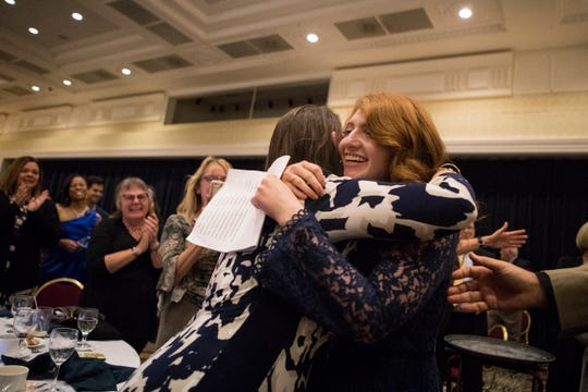 Fourth year special education teacher at the Colwyck Center Rebecca Vitelli receives hugs from colleagues and family after being named the Delaware Department of Education 2020 Teacher of the Year Tuesday night at Dover Downs Hotel & Casino.