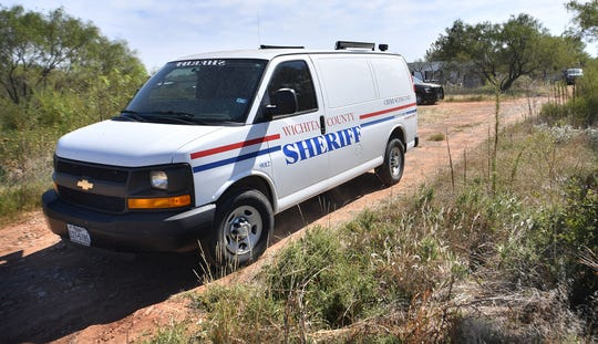 A Wichita County Sheriff's Office Crime Scene Unit leaves a home in the 3800 block of Farm-to-Market 368 South, southwest of Iowa Park, on the afternoon of Oct. 16 where the WCSO seized over 30 animals.