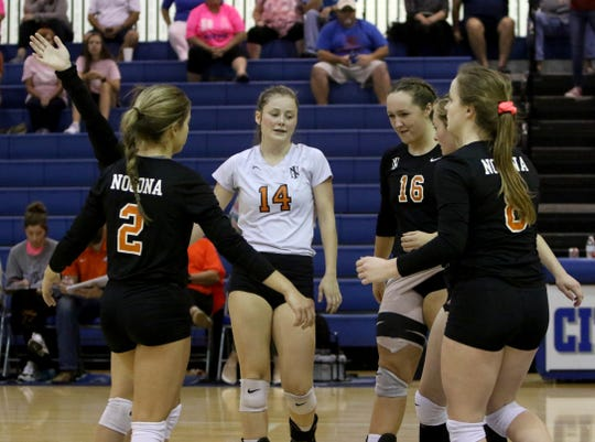 Nocona's Trystin Fenoglio, left, Ellen Yates, Averee Kleinhans, Jessica Dingler and Sydni Messer celebrate winning a point against City View Tuesday, Oct. 15, 2019, at City View.