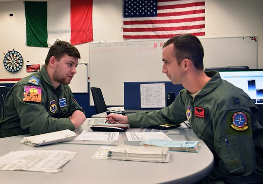 Capt. Maximillian Clukey, right, briefs Romanian student pilot 1st Lt. Razvan Macovei, on a T-6 training flight at Sheppard Air Force Base. Romania is the newest member of the 14-country alliance in the Euro-NATO Joint Jet Pilot Training program.