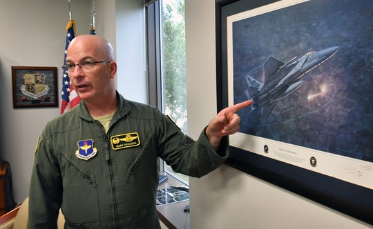 Col. Russ Driggers, commander of the 80th Flying Training Wing at Sheppard Air Force Base, talks about a picture in his office of an Operation Allied Force mission he was part of over Northern Serbia in 1999.