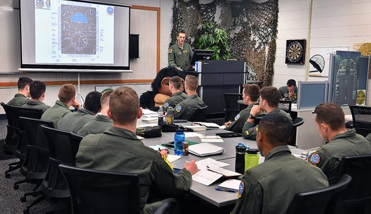 Capt. Brock Logan conducts an instrument briefing for T-38 student pilots in the ENJJPT program at Sheppard Air Force Base.