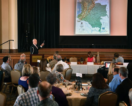 Allen Lazenby Jr. talks about the challenges of drilling for and producing oil in the region around Bogata, Columbia in the late 1980s and early 90s. Lazenby was the keynote speaker at the Desk and Derrick Club's 68th Industry Appreciation Luncheom Wednesday.