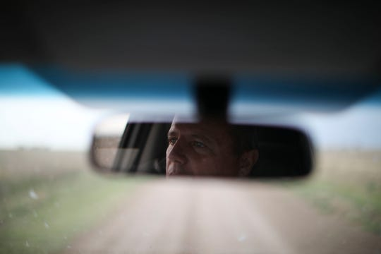 In this Oct. 9, 2019 photo, farmer Juan Rossi is reflected in his rearview mirror on the outskirts of Pergamino, Argentina. Farmers like Rossi are bracing for a return of interventionist policies if a populist ticket returns to power. Export restrictions under former President Cristina Fernandez triggered a revolt by farmers in 2008 in one of the world's top suppliers of grains.