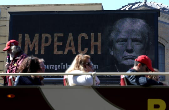 An electronic billboard in San Francisco urges President Donald Trump's impeachment.