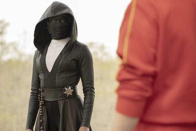"""Masked cop Angela Abar (Regina King) leads the effort against the white supremacist group Seventh Kavalry in """"Watchmen."""""""