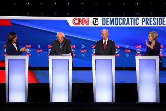 Sen. Kamala Harris speaks as Sen. Bernie Sanders, former Vice President Joe Biden, and Sen. Elizabeth Warren look on during the Democratic Presidential Debate at Otterbein University on October 15, 2019 in Westerville, Ohio.
