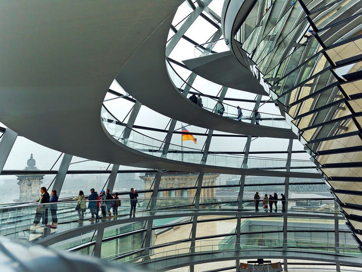 At the Reichstag in Berlin, visitors are treated to endless vistas as they spiral up the 80-foot-high glass dome.