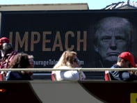 """SAN FRANCISCO, CALIFORNIA - OCTOBER 15: An electronic billboard in the Fisherman's Wharf area of San Francisco reads """"IMPEACH"""" with an image of U.S. President Donald Trump on October 15, 2019 in San Francisco, California. The Courage Campaign commissioned the billboard calling for impeachment as an impeachment inquiry by Democrats in the U.S. House of Representatives is underway in Washington D.C. (Photo by Justin Sullivan/Getty Images) ORG XMIT: 775421947 ORIG FILE ID: 1181294360"""