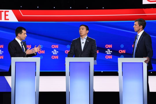 Democratic presidential hopefuls, Mayor of South Bend, Indiana Pete Buttigieg (L), entrepreneur Andrew Yang (C), former Representative for Texas Beto O'Rourke, participate in the fourth Democratic primary debate of the 2020 presidential campaign.