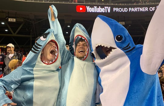 Nationals fans dress up in shark costumes. 'Baby Shark' has become the team's theme song this season.