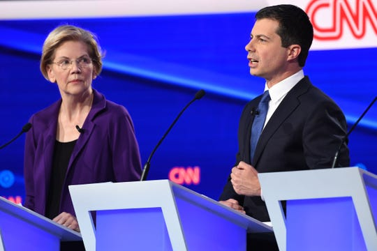 Elizabeth Warren and Pete Buttigieg at the Democratic debate in Westerville, Ohio, on Oct. 15, 2019.