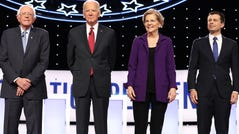 Sen. Bernie Sanders, former Vice President Joe Biden, Sen. Elizabeth Warren and South Bend, Indiana, Mayor Pete Buttigieg are introduced before the Democratic Presidential Debate at Otterbein University in Westerville, Ohio.