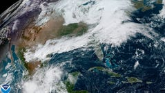 A satellite image of the U.S. taken Wednesday morning, October 16, 2019, shows a storm strengthening over the Northeast.