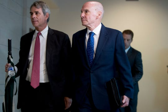 Michael McKinley, a former top aide to Secretary of State Mike Pompeo, right, arrives on Capitol Hill in Washington, Wednesday, Oct. 16, 2019, to testify before congressional lawmakers as part of the House impeachment inquiry into President Donald Trump.