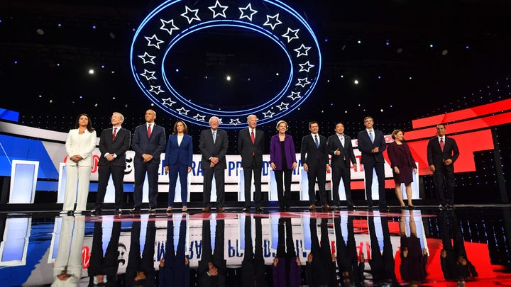 Twelve Democratic presidential hopefuls arrive on stage for the fourth Democratic primary debate of the 2020 presidential campaign season co-hosted by The New York Times and CNN at Otterbein University in Westerville, Ohio.