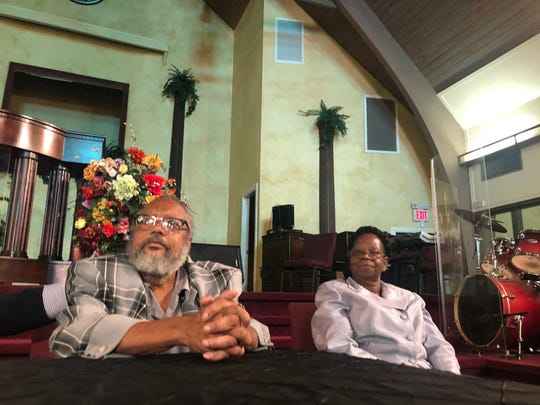 Marquis Jefferson, Atatiana Jefferson's father, and his wife, Noella, meet with reporters at a church in Dallas.