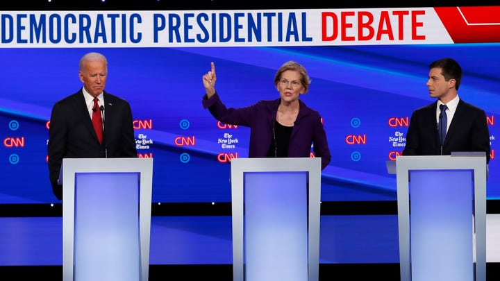 Democratic presidential candidate former Vice President Joe Biden, left, Sen. Elizabeth Warren, D-Mass., and South Bend Mayor Pete Buttigieg, right, participate in a Democratic presidential primary debate hosted by CNN/New York Times at Otterbein University on Oct. 15, 2019, in Westerville, Ohio.