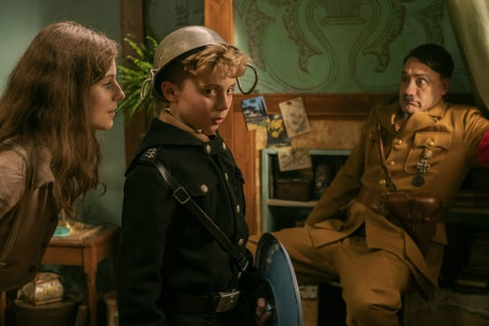 "Jewish girl Elsa (Thomasin McKenzie, left)  throws young Jojo (Roman Griffin Davis) and Adolf Hitler (Taika Waititi) for a loop in the anti-war, pro-love satire ""Jojo Rabbit."""