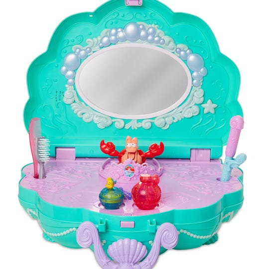 Freshen up at Ariel's clamshell vanity.