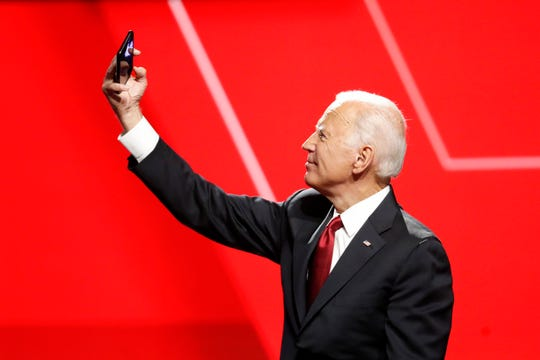 Democratic presidential candidate former Vice President Joe Biden takes a photo following a Democratic presidential primary debate hosted by CNN/New York Times at Otterbein University, on Oct. 15, 2019.