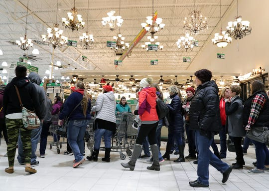 Shoppers streamed through the doors of Menards in Grand Chute last year on Black Friday. The store was closed on Thanksgiving Day and opened early Friday to shoppers.