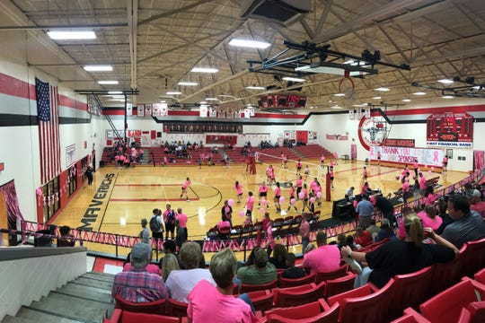 In a decorated Marshall Gym in Eastland, the Lady Mavericks and Early warm up for a volleyball match Tuesday on Pink Out night.