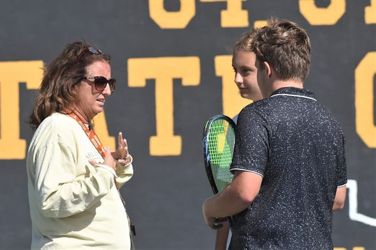 Abilene High coach Stacy Bryan, left, talks to her mixed doubles team of Hunter Lee and Tia Pupella during a break in their match against Midland High's Trystan Fernandez and Kristin Thompson. The AHS duo won the match 3-6, 6-0, 10-8 to help the Eagles beat Midland 10-1 in the Region I-6A area playoff match Oct. 17 at the AHS courts.