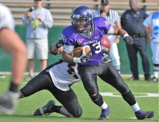 ACU receiver Jerale Badon tries to shake off a defender after making a catch. The Abilene High grad will be inducted into the ACU Sports Hall of Fame on Friday, Oct. 18, 2019. He played four seasons (2004-07) for the Wildcats.