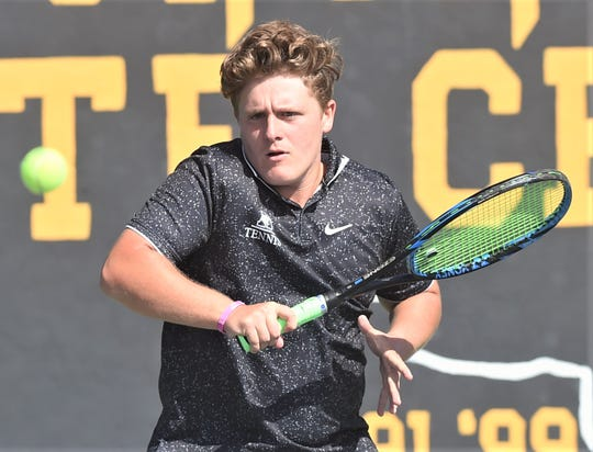 Abilene High's Hunter Lee hits a return to Midland High's Trystan Fernandez and Kristin Thompson. Lee and Tia Pupella won the mixed doubles match 3-6, 6-0, 10-8 in the Eagles' 10-1 victory over Midland High in a Region I-6A area playoff match Oct. 17 at the AHS courts.