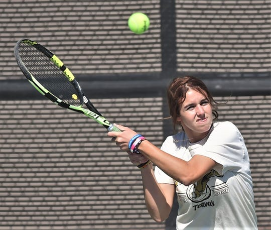 Abilene High's McKenna Bryan returns a shot to Midland High's Montserrat Salazar. Bryan won the singles match 6-0, 6-0, and the Eagles beat the Bulldogs 10-1 in the Region I-6A area playoff Oct. 17 at the AHS courts. Bryan will play at Hardin-Simmons in the fall.