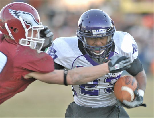 ACU receiver Jerale Badon fends off a defender after making a catch. The Abilene High grad will be inducted into the ACU Sports Hall of Fame on Friday, Oct. 18, 2019. He played four seasons (2004-07) for the Wildcats.