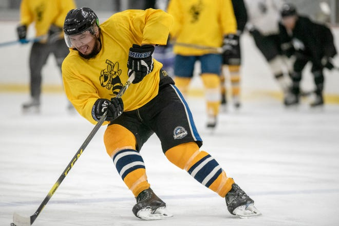 LeeJay Meguinis hits the puck during the Battle Creek Rumble Bees preseason training camp on Thursday, Oct. 17, 2019 at The Rink in Battle Creek, Mich.