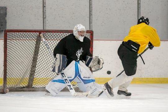 Goalie Kevin O'Shea catches the puck during the Battle Creek Rumble Bees preseason training camp on Thursday, Oct. 17, 2019 at The Rink in Battle Creek, Mich.