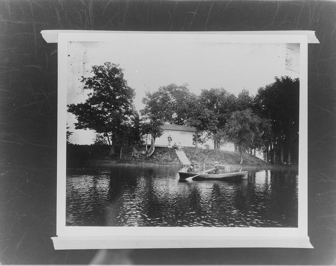 """This photo, published in the Enquirer and News on Oct. 31, 1971, shows Ward Cottage on Ward's Island at Goguac Lake in about 1900.  """"The Soul of Stephen Strand,"""" a story of  transmigration of souls, is set at a cabin on an island at Goguac Lake."""