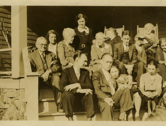 In this 1930 Thanksgiving Day 1930 photograph, friends, family, and guests gather at the 109 Church Street boarding house, the house Seidel would buy more than 30 years later. Pictured here are, front row, left to right: Charles A. Seidel, Duane Champlain, Mary Jane, Mary Beth, Ann Mary Maddox (out of frame) and Elizabeth (dog); (second row, left to right) Daniel Cody Champlain, Ann Wilson, Georgina, Albert, Lyde Wilson, and Fan Mary; (top row, left to right) Bess, Emma (standing), Eunice Dawson (in rocker), and Mary Mosely (in rocker).