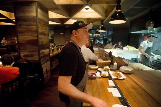Eric Warnstedt, chef and co-owner of Hen of the Wood, at his Burlington restaurant. Warnstedt opened his first Hen of the Wood restaurant in Waterbury in October 2005.