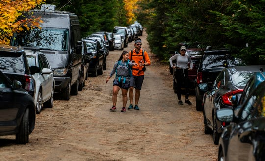 Hikers and cars choke the access road to the South Meadow trailhead on Saturday, Oct. 12, 2019, in the High Peaks Wilderness Area and the primitive camping area in North Elba, NY. So many cars packed the access road the cars could barely pass one-way. One New York Forest Ranger commented that it would be impossible to get emergency vehicles, like an ambulance, down that road.