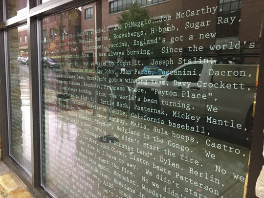 "Lyrics from the Billy Joel song ""We Didn't Start the Fire"" are posted in a window at Hen of the Wood in Burlington on Oct. 17, 2019."