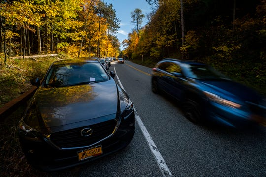 A ticket rests on the windshield of an illegally-parked car on Route 73 in St. Huberts, NY, near the Roaring Brook trailhead on Saturday, Oct. 12, 2019. The Department of Environmental Conservation instituted a temporary 45 mph speed limit in the area, increased law enforcement of no-parking zones, and other measures to help better manage the high volume of people coming to the High Peaks region of the Adirondack Park.